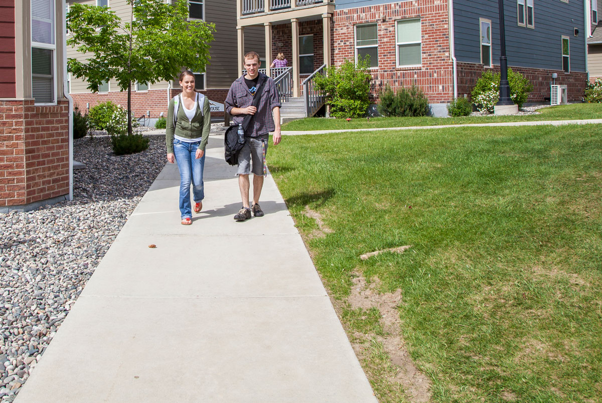 Students talking and walking on campus