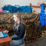 Gillette College Housing Inspiration Hall Student at Desk