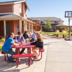 Gillette College Housing Tanner Village Outside at Table